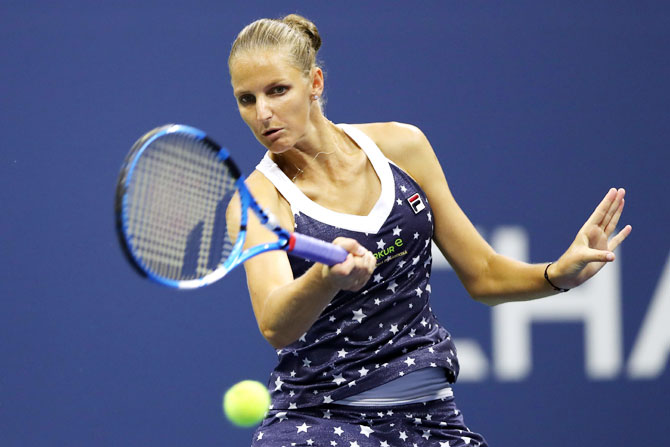 Czech Republic's Karolina Pliskova returns the ball during her women's singles quarter-final against USA's Serena Williams