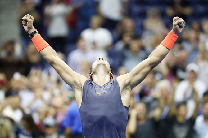 Spain's Rafael Nadal celebrates his five-set win over Austria's Dominic Thiem in the US Open men's singles quarter-final in the Flushing neighborhood of the Queens borough of New York City on Tuesday