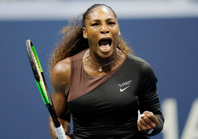 USA's Serena Williams reacts after winning a game in the second set during her quarter-final against Czech Republic's Karolina Pliskova at USTA Billie Jean King National Tennis Center