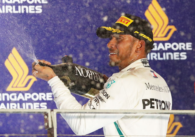 Rediff Sports - Cricket, Indian hockey, Tennis, Football, Chess, Golf - F1: Hamilton opens 40-point lead with Singapore GP triumph