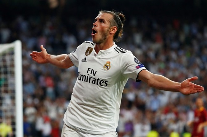 Rediff Sports - Cricket, Indian hockey, Tennis, Football, Chess, Golf - Champions League PICS: Real Madrid rout Roma; Lyon stun Man City
