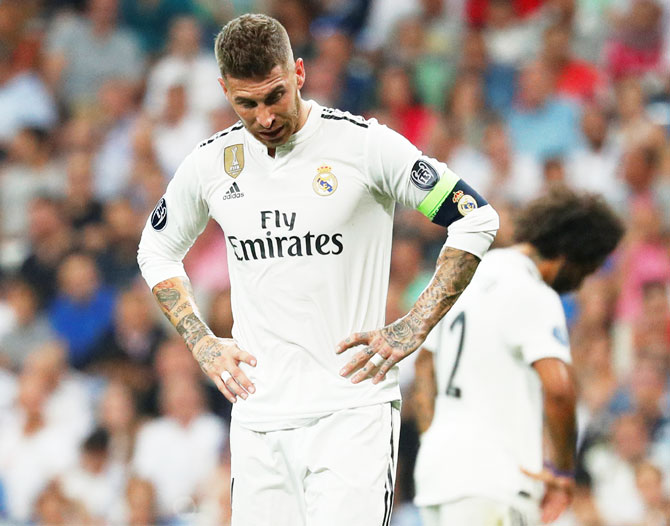 Rediff Sports - Cricket, Indian hockey, Tennis, Football, Chess, Golf - Ramos beats Scholes for this unwanted Champions League record