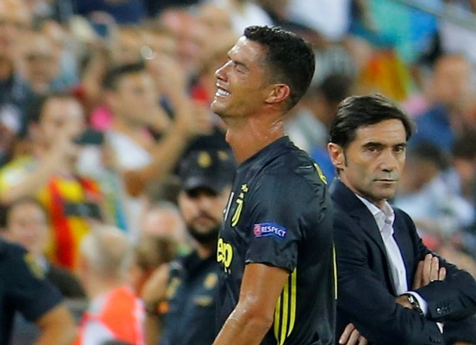 Rediff Sports - Cricket, Indian hockey, Tennis, Football, Chess, Golf - PHOTOS: Ronaldo sees red as Juventus beat Valencia