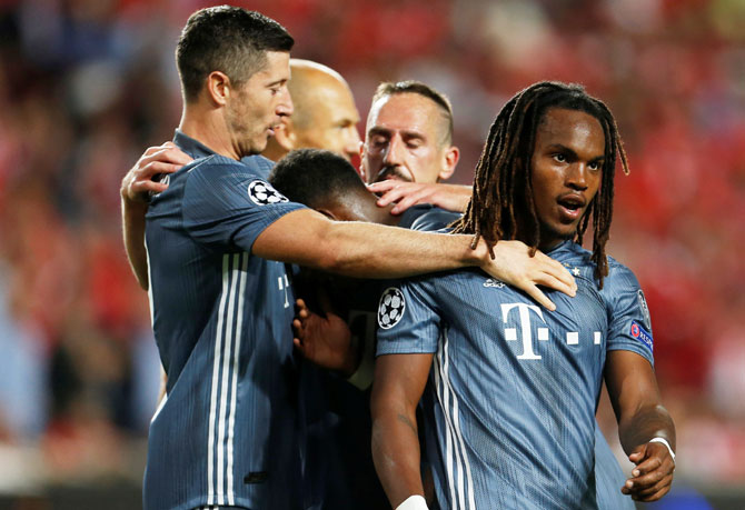 Bayern Munich's Renato Sanches (right) celebrates with Robert Lewandowski and teammates after scoring their second goal against Benfica on Wednesday