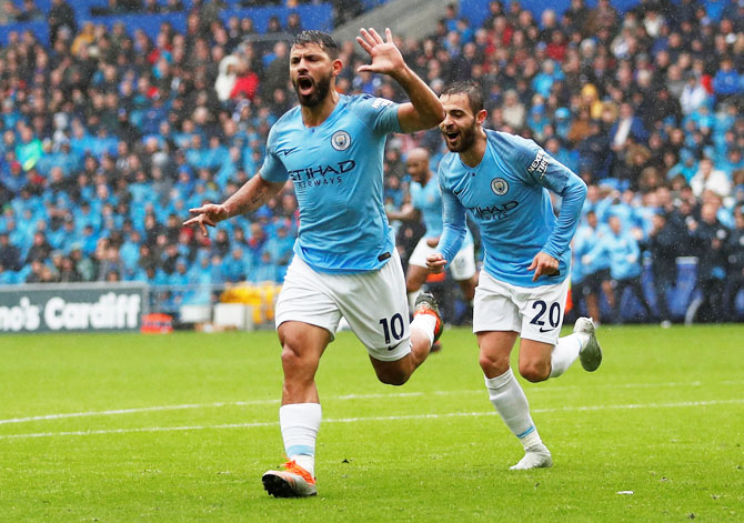 Manchester City's Sergio Aguero celebrates with Bernardo Silva after scoring their first goal against Cardiff City