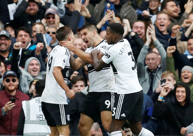 Fulham's Aleksandar Mitrovic celebrates scoring their first goal with Luciano Vietto and Ryan Sessegnon during their match against Watford at Craven Cottage in London on Saturday