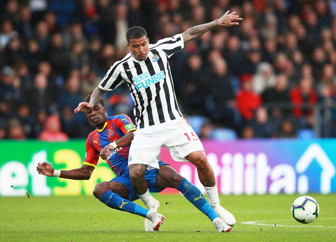 Crystal Palace's Wilfried Zaha in action with Newcastle United's Kenedy