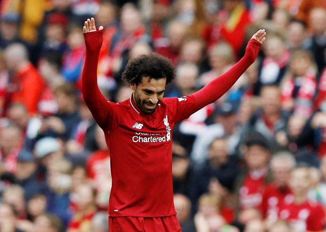 EPL PHOTOS: Salah helps Liverpool hammer Southampton to go top