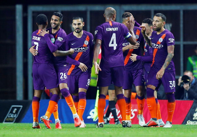 Manchester City's Riyad Mahrez celebrates scoring their second goal with teammates