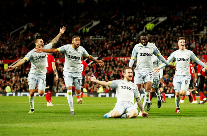 Derby County's Jack Marriott celebrates scoring their second goal with teammates during their Third Round League Cup match at Old Trafford, in Manchester on Tuesday