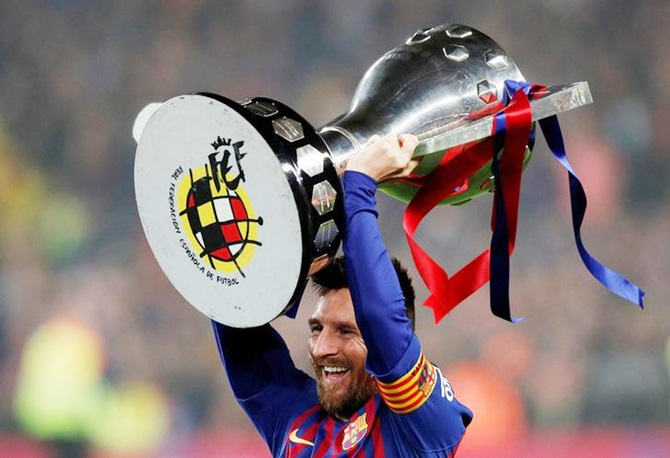 f0eb4371624 PIX  Messi seals La Liga for Barca  Ronaldo hits 600 - Rediff Sports