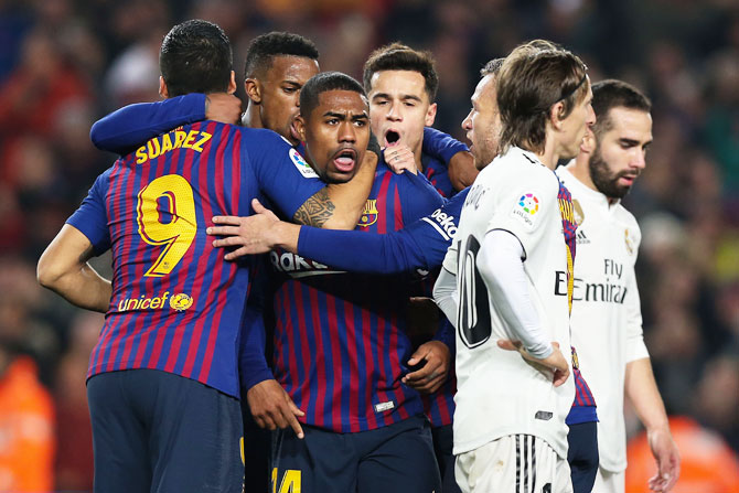 Rediff Sports - Cricket, Indian hockey, Tennis, Football, Chess, Golf - King's Cup: Malcom rescues draw for Barcelona in Clasico
