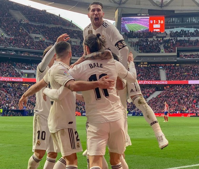 Rediff Sports - Cricket, Indian hockey, Tennis, Football, Chess, Golf - La Liga: Real back in title fight after Madrid derby victory