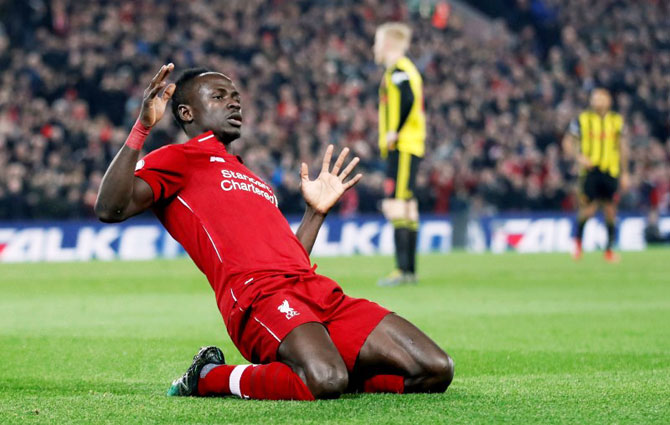 EPL PHOTOS: Liverpool, City march on as Spurs slip again