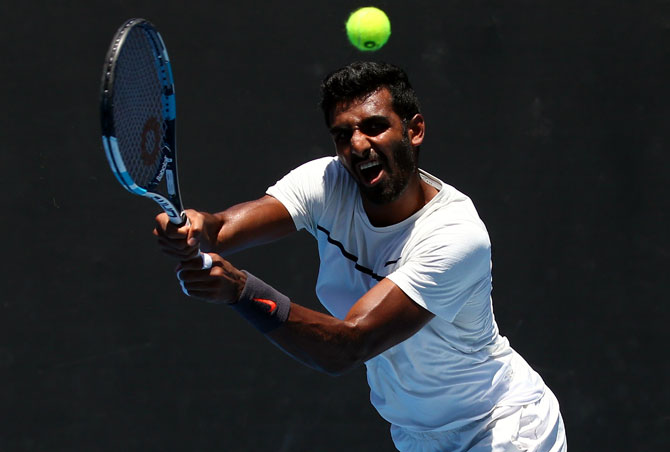 Rediff Sports - Cricket, Indian hockey, Tennis, Football, Chess, Golf - Australian Open: Debutant Prajnesh loses in first round