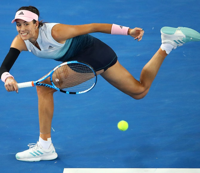 Rediff Sports - Cricket, Indian hockey, Tennis, Football, Chess, Golf - Muguruza stars in late, late show at Melbourne Park