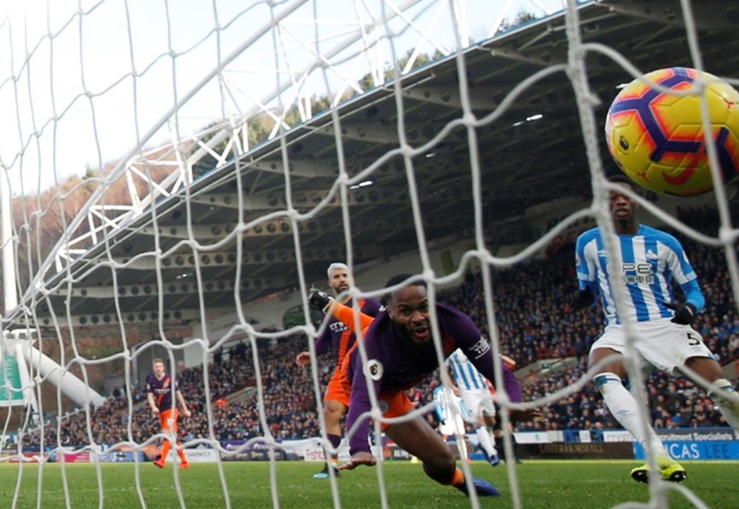 EPL: City ease past Huddersfield to close gap on Liverpool