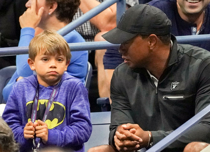 Tiger Woods battling son Charlie for green jacket