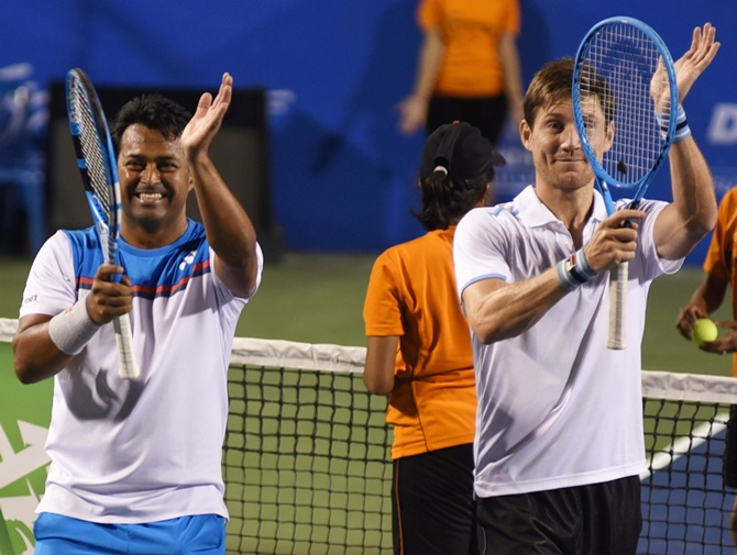 Leander Paes and Matthew Ebden celebrate victory over Jonathan Erlich and Andrei Vasilevski in the doubles semi-final at the Bengaluru Open on Friday.