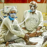 Two patients to a bed as India's healthcare systems fail