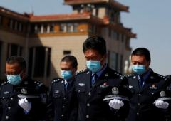 China halts to honour coronavirus victims, 'martyrs'
