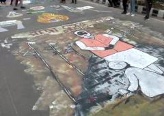 PIX: Jamia students paint road with anti-CAA graffiti