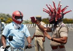 Chennai cop wears 'corona helmet' to spread awareness