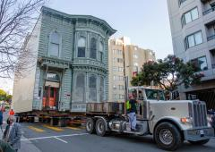 Victorian house moved through streets of San Francisco