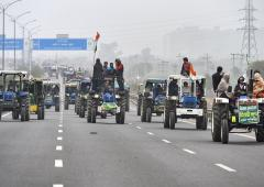 Farmers take out tractor march against farm laws
