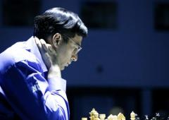 Vishy Anand stays third after playing out an easy draw