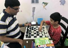 Anand celebrates International Chess Day with son