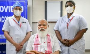 Kerala man petitions EC over PM's pic on vaccine paper