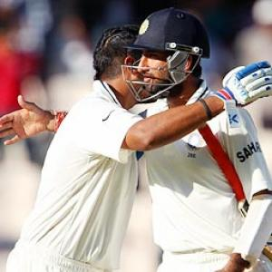 India off to slow start after Australia have Sehwag early