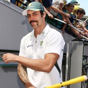 Mitch Johnson finally shaves off 'filthy moustache' for charity