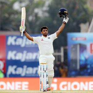 PHOTOS: Nair's triple century propels India to record total