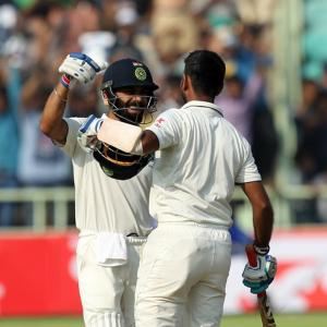 PHOTOS: Kohli, Pujara punish England on day 1
