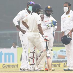 Sri Lanka go behind masks after Kohli's record double