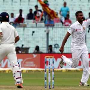 PHOTOS: Pujara, rain thwart Sri Lanka's charge on Day 2