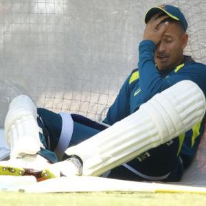 Australian cricketer Khawaja must sort out off-field problems