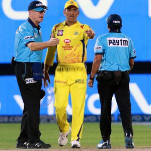 Dhoni loses his cool, storms on to the field