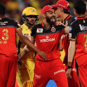 IPL PHOTOS: MS excels, but RCB win off last ball
