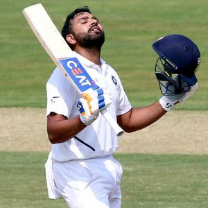 PHOTOS: Rohit's century powers India on rain-hit Day 1