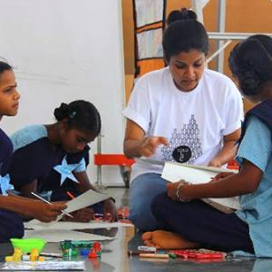 She quit a cushy job to teach tribal kids to paint