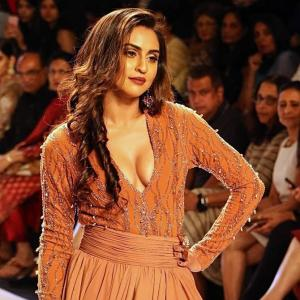 Oomphalicious! Krystle D'Souza puts on a daring display