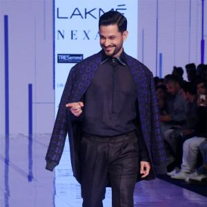 Kunal does a smooth moonwalk on the runway