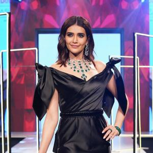 Bold! Karishma slays in a black off-shoulder gown
