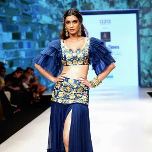 Diana Penty looks so good in this high-slit skirt