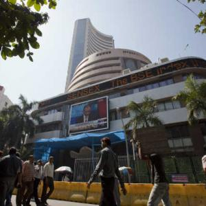 Markets end flat; Commodity stocks rally