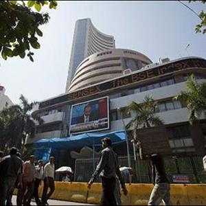 Sensex loses 88 points, Nifty ends below 6,000