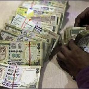 Re ends 12 paise down at 54.61